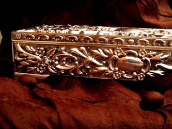 Jewelry Boxes come in all sizes, shapes and materials.  This photo of an elegant silver jewelry box (or casket) with repousse detailing was taken by an unknown photographer.